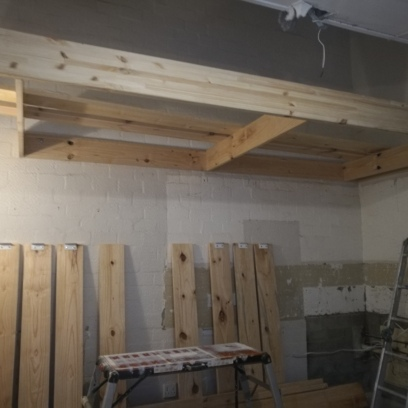 During Building: New Ceiling for kitchen as well as a floor for loft - raw pine and white melamine